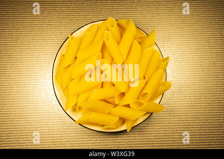 Rigatoni penne Italian dry raw pasta Top view. Selective focus with copy space for text. - Stock Image