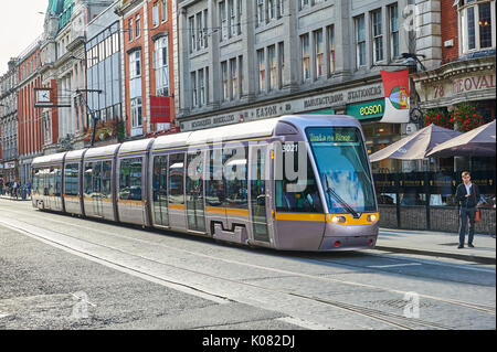 A silver tram in Dublin City Centre - Stock Image