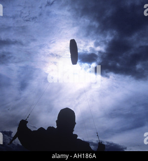 Eric Rosenfeld 23 flying practice power traction kite for kite surfing and kite skiing at sunset in New Hampshire - Stock Image