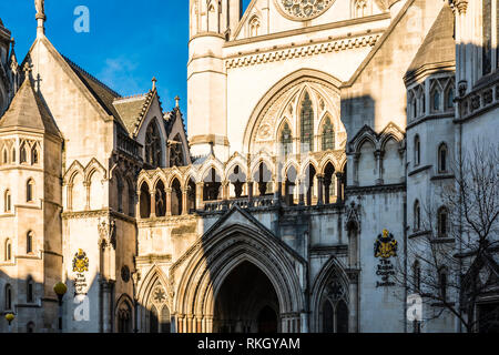 Morning sun over the main entrance to the Royal Courts of Justice, The Strand, London, UK - Stock Image