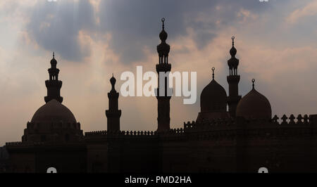 Silhouette shot of minarets and domes of  Sultan Hasan mosque and Al Rifai Mosque, Old Cairo, Egypt - Stock Image