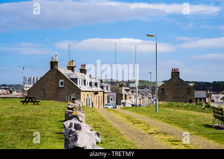 Traditional Scottish houses on Grant Street in historic village seen from headland. Burghead, Moray, Scotland, UK, Britain - Stock Image