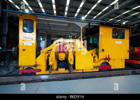 A Track ballast tamping machine used to maintain railway track 1940s to 1980s on display in Locomotion the National Railway Museum at Shildon - Stock Image