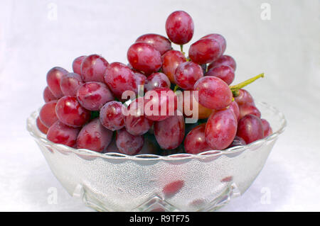 Bunch of Red Seedless Grapes in a Glass Bowl - Stock Image