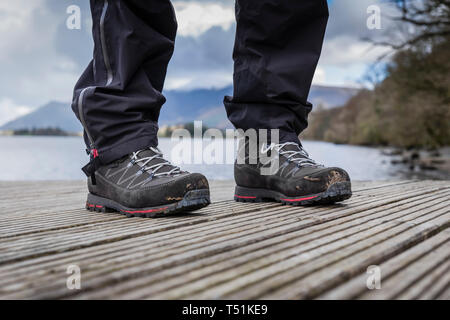 Walking boots on Ashness landing stage, Cumbria, UK. - Stock Image