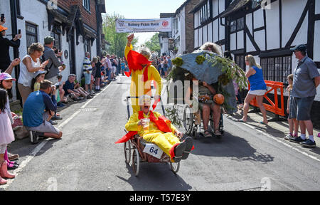 Bolney Sussex, UK. 22nd Apr, 2019. Competitors take part in the annual Bolney Pram Race in hot sunny weather . The annual races start and finish at the Eight Bells Pub in the village every Easter Bank Holiday Monday Credit: Simon Dack/Alamy Live News - Stock Image