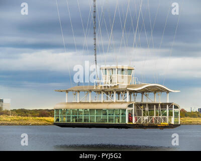 The Gondola on the Grade 2 listed Transporter Bridge over the river Tees at Middlesbrough approaching the North bank - Stock Image