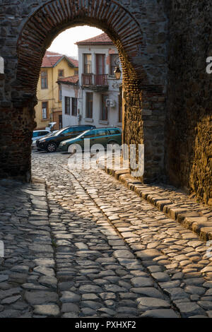 Cobblestone street and archway in Old Town of Plovdiv, Bulgaria - Stock Image