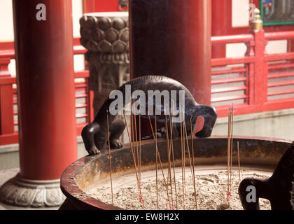 Incense burning at Temple in Singapore - Stock Image