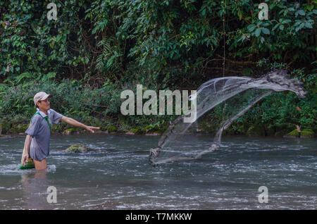 Fisherman at work in a river in the Laotian countryside, Phongsali, Laos - Stock Image