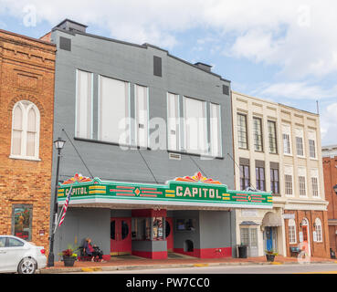 Greeneville, TN, USA-10-2-18: The Capital theater in downtown.  A  woman sits waiting on a bench on the sidewalk. - Stock Image