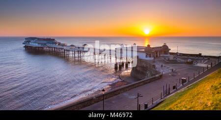 Sunrise over Cromer pier. - Stock Image