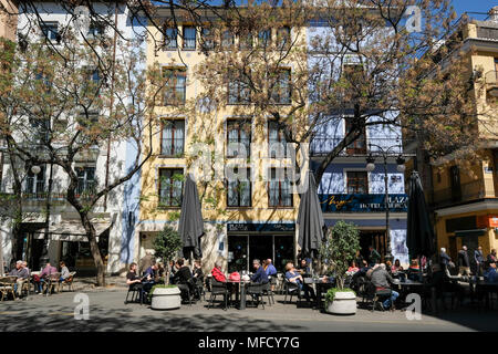 People sitting outside at cafes on popular Placa del Mercat, North Ciutat Vella district, Valencia, Spain - Stock Image