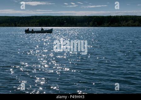 Fishing from boat on sparkling lake, Dore Lake, Saskatchewan, Canada - Stock Image