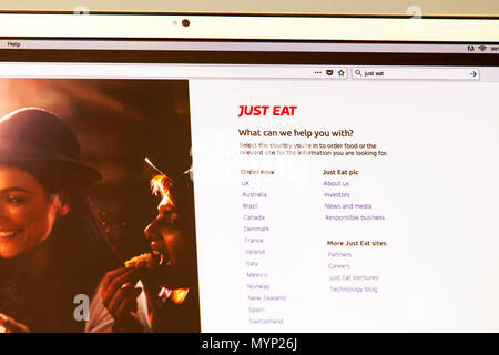 Just Eat, Just Eat UK, Just Eat plc is an online food order and delivery service, Just Eat app, Just Eat app uk, Just Eat order food, online order - Stock Image