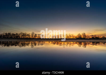Frozen morning by the river under the sunrise heaven. - Stock Image