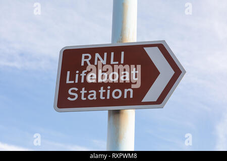 Brown tourist sign indication direction to RNLI lifeboat station St Annes on Sea Fylde Coast February 2019 - Stock Image