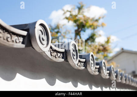 Japanese tiled roof with swirl design end caps - Stock Image