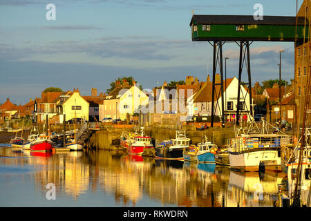 View of the Quay at Wells next the sea showing moored fishing boats and the east end harbour. - Stock Image