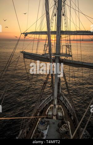 The view from the mast lookout of the Lord Nelson Sailing ship at sunset. - Stock Image