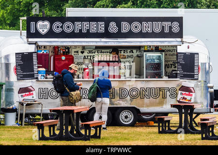 Coffee and Donuts food stand at an outdoor event - Stock Image
