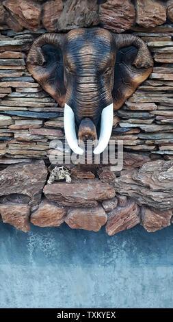 Elephant Head Statue wall - Stock Image