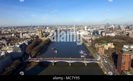 Aerial View of Central London feat. Big Ben Clock Tower Houses of Parliament and London Eye Wheel in Westminster with Bridge and Boats on Thames River - Stock Image