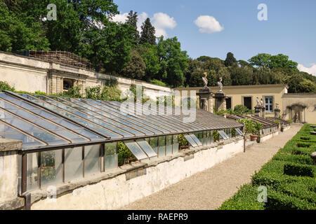 Greenhouses in the formal Renaissance gardens of the Medici Villa di Castello (Villa Reale), Sesto Fiorentino, Florence, Italy. - Stock Image