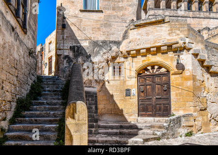 An ornate door on a typical back street in the ancient sassi of Matera Italy. - Stock Image