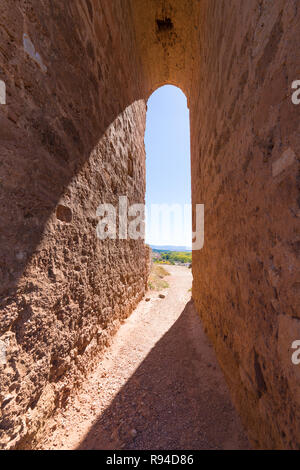 high arch in famous tower known as La Martina, landmark and public monument from Arab age, in top of old town of Ayllon village, Segovia, Spain, Europ - Stock Image