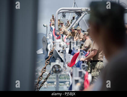 180829-N-ND356-0057 PEARL HARBOR (Aug. 29, 2018) USS Missouri Chief Petty Officer (CPO) Legacy Academy Class 019 members affix bunting to the rails of the USS Battleship Missouri Memorial during a service project. The CPO Legacy Academy is a six-day course in which the chief petty officers and selectees live aboard The USS Battleship Missouri Memorial and participate in preservation activities, leadership training, reenact scenarios that took place aboard USS Missouri, and learn lessons about the history and heritage of the U.S. Navy and CPO community. The CPO Legacy Academy has taken place ab - Stock Image