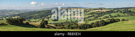 UK rural landscape. Panoramic view from Stonewall Hill (near Knighton, Powys) towards the distant Black Mountains - Stock Image