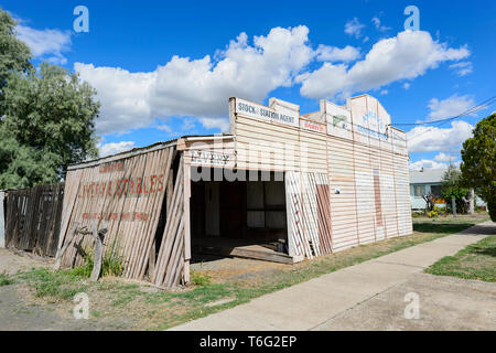 Historic wooden livery and stables and general store painted frontage, Injune, South West Queensland, QLD, Australia - Stock Image