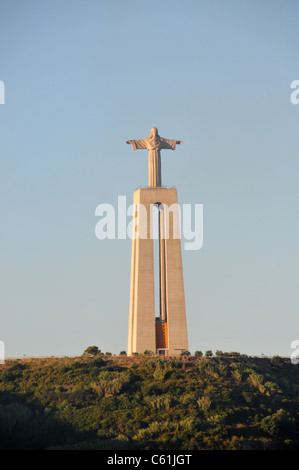 Statue of Christ, (Cristo Rei), overlooking River Tagus, Lisbon, Portugal - Stock Image