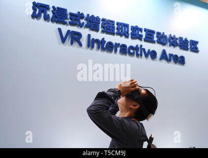 (190423) -- BEIJING, April 23, 2019 (Xinhua) -- A journalist tries virtual reality devices at the VR Interactive Area of the Media Center for the second Belt and Road Forum for International Cooperation in Beijing, capital of China, on April 23, 2019. The media center started trial operation at the China National Convention Center in Beijing Tuesday. More than 4,100 journalists, including 1,600 from overseas, have registered to cover the second Belt and Road Forum for International Cooperation to be held from April 25 to 27 in Beijing. (Xinhua/Zhang Chenlin) - Stock Image