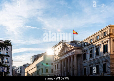 Madrid, Spain - April 14, 2019: Scenic view of the Congress of Deputies of Spain in Madrid a sunny day with sun flares at evening. - Stock Image
