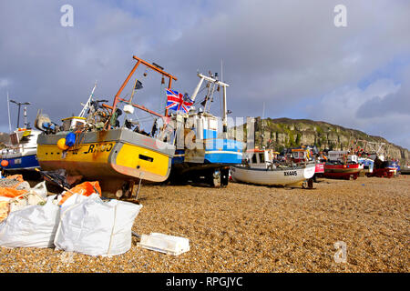 Hastings fishing boats pulled up on the Old Town Stade beach, East Sussex, UK - Stock Image