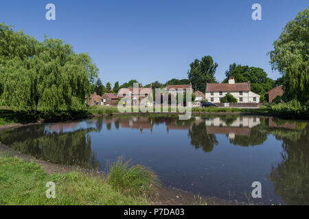 A view across the duck pond in the picture postcard village of Nun Monkton; North Yorkshire, UK - Stock Image