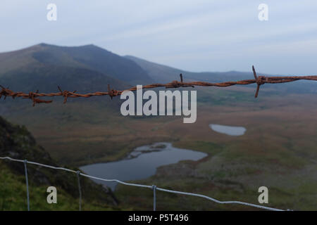 Fenced Views over looking Dingle Peninsula from Conor Pass ( Connor Pass ). County Kerry, Ireland. - Stock Image