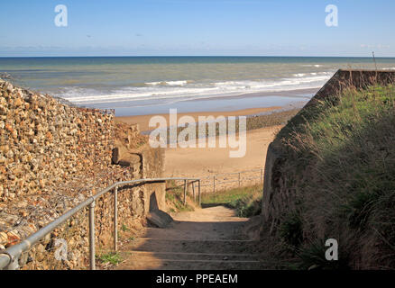 A view of the beach from access steps on the North Norfolk coast at East Runton, Norfolk, England, United Kingdom, Europe. - Stock Image
