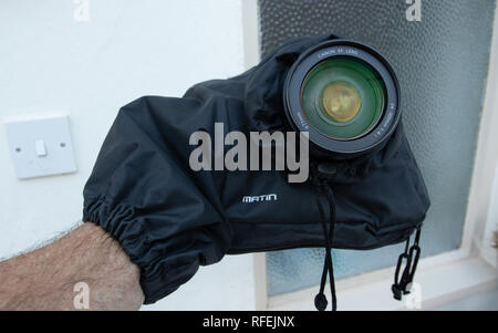 Matin brand rain cover for a SLR camera - Stock Image