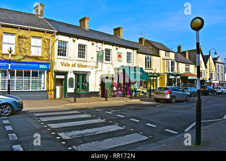 A general street view of the High Street in Cowbridge with it's eclectic mix of famous brands and small local specialist shops.Vale of Glamorgan pub. - Stock Image
