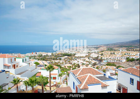 View of the popular resort of Las Americas from the top of San Eugenio Alto neighborhood, the busiest area in the south of Tenerife, Canary Islands - Stock Image
