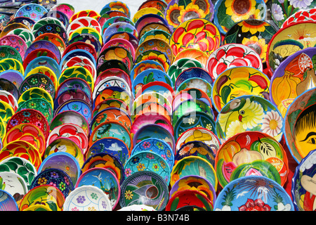 Colourful Maya Design Plates Being Sold at Chichen Itza Archeological Site Yucatan Mexico - Stock Image