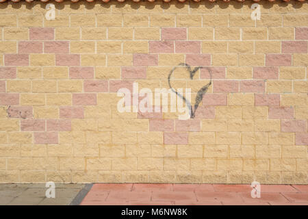 Graffiti heart on a wall. - Stock Image