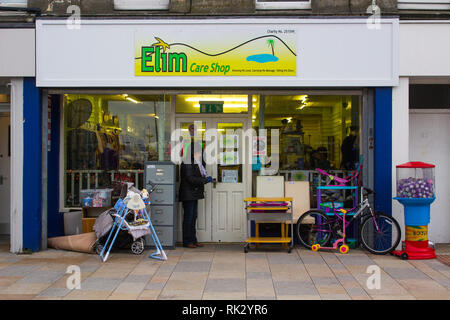 14 December 2018 A small  Elim Pentecostal Charity Shop in Newcastle County Down Northern Ireland on a dull midwinter day leading up to Christmas - Stock Image
