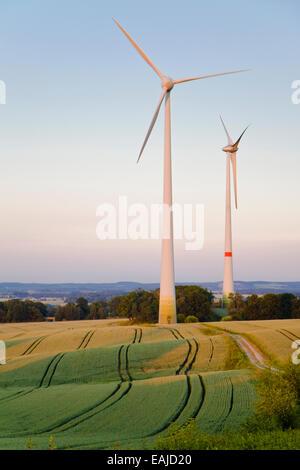 Windmills at dusk, an alternative energy source - Stock Image