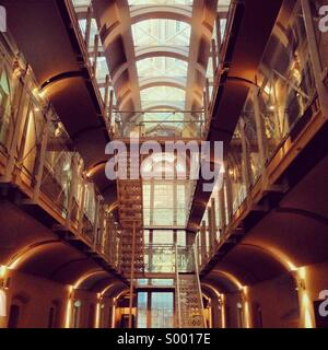 Interior of a refurbished and repurposed old prison - Stock Image