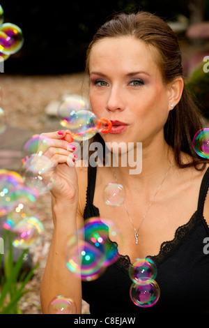 Rachel Parker blows Bubbles - Stock Image