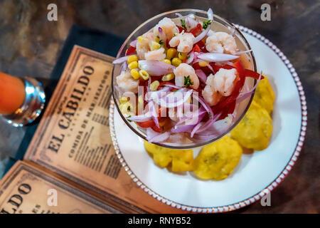 Cartagena Colombia Old Walled City Center centre Getsemani El Cabildo restaurant inside menu shrimp ceviche - Stock Image
